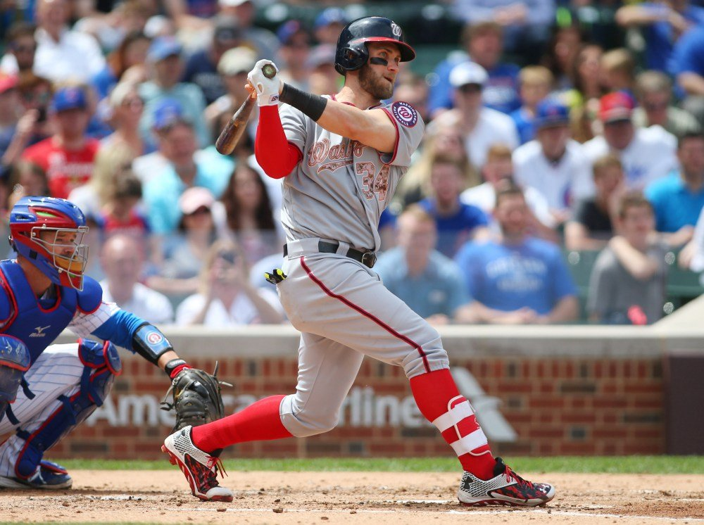 May 25, 2015; Chicago, IL, USA; Washington Nationals right fielder Bryce Harper (34) hits a double during the fourth inning against the Chicago Cubs at Wrigley Field. Mandatory Credit: Caylor Arnold-USA TODAY Sports ORG XMIT: USATSI-214696 ORIG FILE ID:  20150525_jla_ca2_103.jpg
