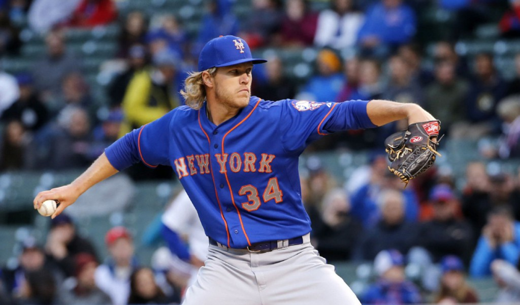 New York Mets starting pitcher Noah Syndergaard throws during the first inning of a baseball game against the Chicago Cubs on Tuesday, May 12, 2015, in Chicago. (AP Photo/Charles Rex Arbogast)
