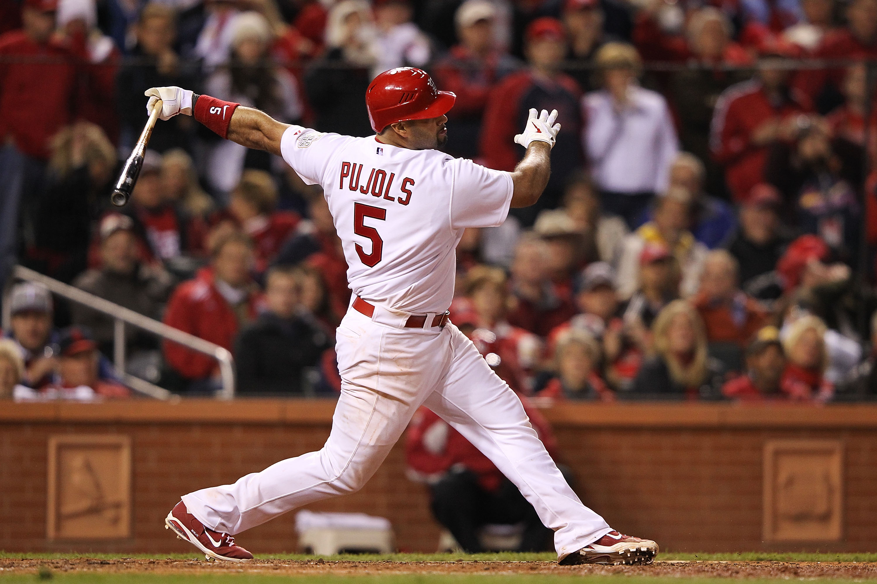ST LOUIS, MO - OCTOBER 28:  Albert Pujols #5 of the St. Louis Cardinals strikes out in the seventh inning during Game Seven of the MLB World Series against the Texas Rangers at Busch Stadium on October 28, 2011 in St Louis, Missouri.  (Photo by Jamie Squire/Getty Images)