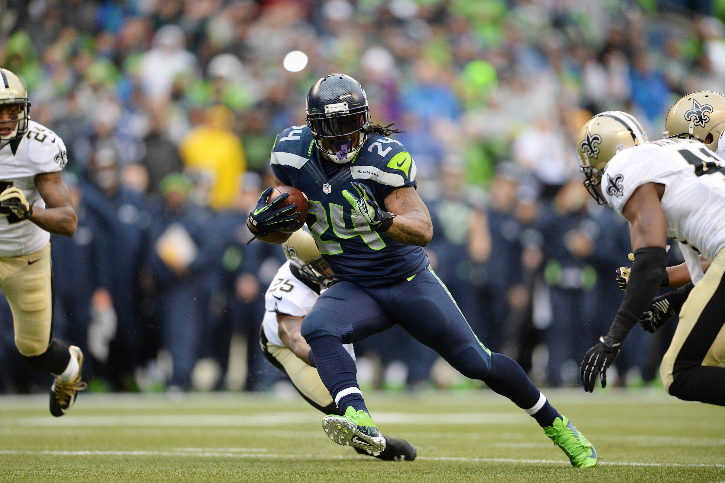 Seattle Seahawks running back Marshawn Lynch (24) heads for a 15-yard touchdown run during an NFC Divisional Playoff game against the New Orleans Saints on Saturday, Jan. 11, 2014, in Seattle. The Seahawks won the game, 23-15. (AP Photo/Greg Trott)