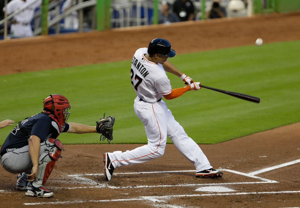 Miami Marlins' Giancarlo Stanton hits a fly ball to second base for an out during the first inning of a baseball game against the Atlanta Braves, Wednesday, April 10, 2013 in Miami. (AP Photo/Wilfredo Lee)