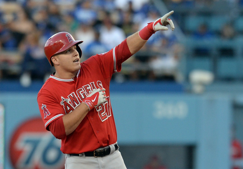 Aug 4, 2014; Los Angeles, CA, USA;   Los Angeles Angels center fielder Mike Trout (27) reacts on second base after he doubled in a run in the first inning of the game Los Angeles Dodgers at Dodger Stadium. Mandatory Credit: Jayne Kamin-Oncea-USA TODAY Sports